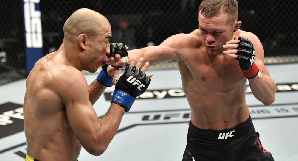 Petr Yan of Russia punches Jose Aldo of Brazil in their UFC bantamweight championship fight during the UFC 251 event at Flash Forum on UFC Fight Island on 12 July 2020 on Yas Island, Abu Dhabi, United Arab Emirates.
