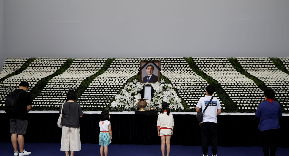 People stand and pay their respects at a memorial altar for late Seoul Mayor Park Won-soon at Seoul City Hall Plaza in Seoul, South Korea 11 July 2020