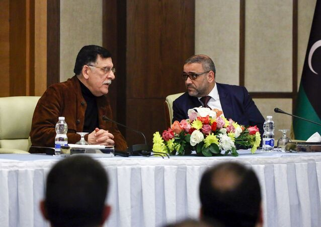 Fayez al-Sarraj (L), head of Libya's Government of National Accord (GNA), and Khalid al-Mishri, head of Libya's Supreme Council of State, attend a press conference in the capital Tripoli on January 15, 2020.