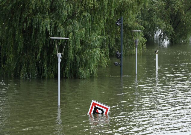 A sign is seen submerged in floodwaters on the bank of the Yangtze River in Nanjing in China's eastern Jiangsu province on July 12, 2020. - Various parts of China have been hit by continuous downpours since June, with the damage adding pressure to a domestic economy already hit by the coronavirus pandemic.