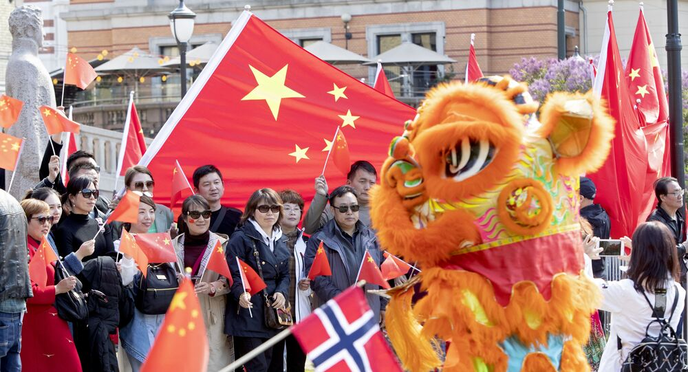 Pro China demonstrators wave flags during the visit of Li Zhanshu, Chairman of the Chinese National People's Congress Standing Committee at the Norwegian Parliament building in Oslo, on May 15, 2019