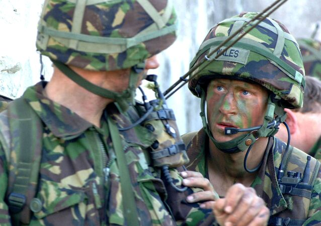 In this picture released by Ministry of Defence in London, Tuesday April 11, 2006, Britain's Prince Harry, right, takes part in his final training exercise, in Cyprus, in March 2006