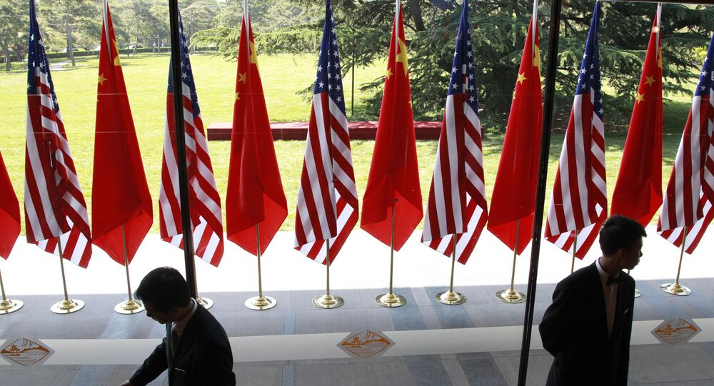 Chinese and US national flags are posted for the opening ceremony of the U.S.- China Strategic and Economic Dialogue at The Diaoyutai state guesthouse in Beijing Thursday, May 3, 2012