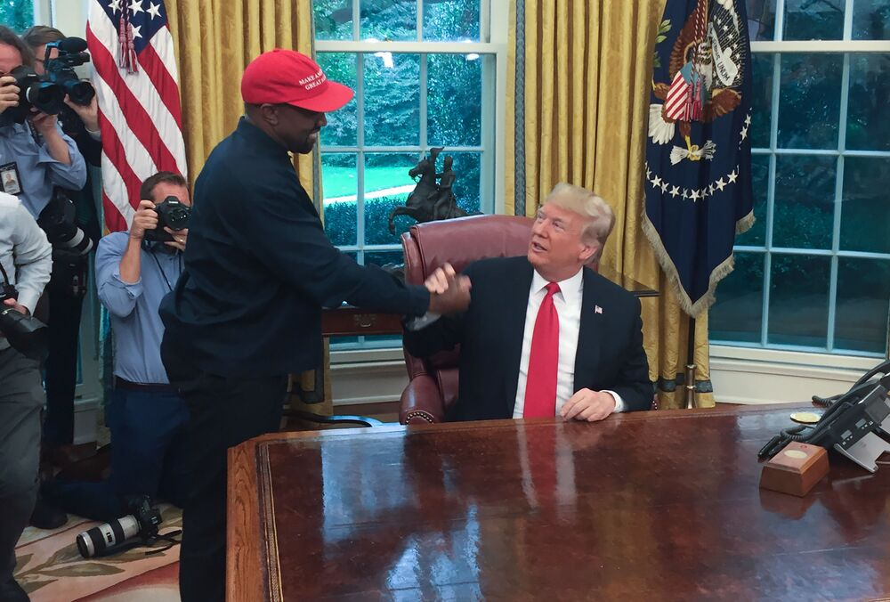 (Files) in this file photo US President Donald Trump meets with rapper Kanye West in the Oval Office in Washington, DC, 11 October 2018. Kanye West, the entertainment mogul who urges listeners in one song to reach for the stars, so if you fall, you land on a cloud, on 4 July 2020, announced he is challenging Donald Trump for the US presidency in 2020.
