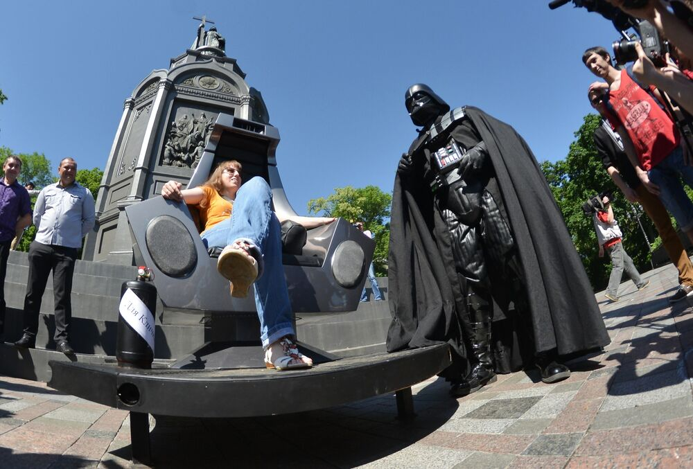 Candidate for mayor of Kiev, Darth Vader, presents his new office equipped with a space throne to the public at an observation deck near the monument to Vladimir the Baptist.