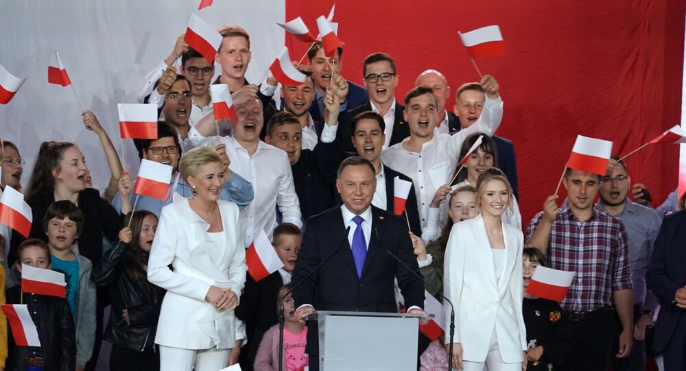 Polish President Andrzej Duda addresses supporters as exit poll results were announced during the presidential election in Pultusk, Poland, on July 12, 2020. - Poland's right-wing head of state Andrzej Duda was ahead by a tiny margin in the presidential run-off against Warsaw's liberal mayor, an exit poll on on July 12, 2020 showed, starting a tense wait for the official results