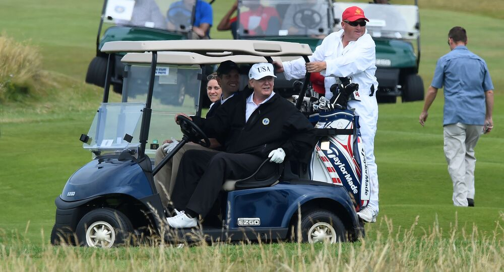 US President Donald Trump (C) sits in a golf cart as he plays a round of golf on the Ailsa course at Trump Turnberry, the luxury golf resort of US President Donald Trump, in Turnberry, southwest of Glasgow, Scotland on July 14, 2018