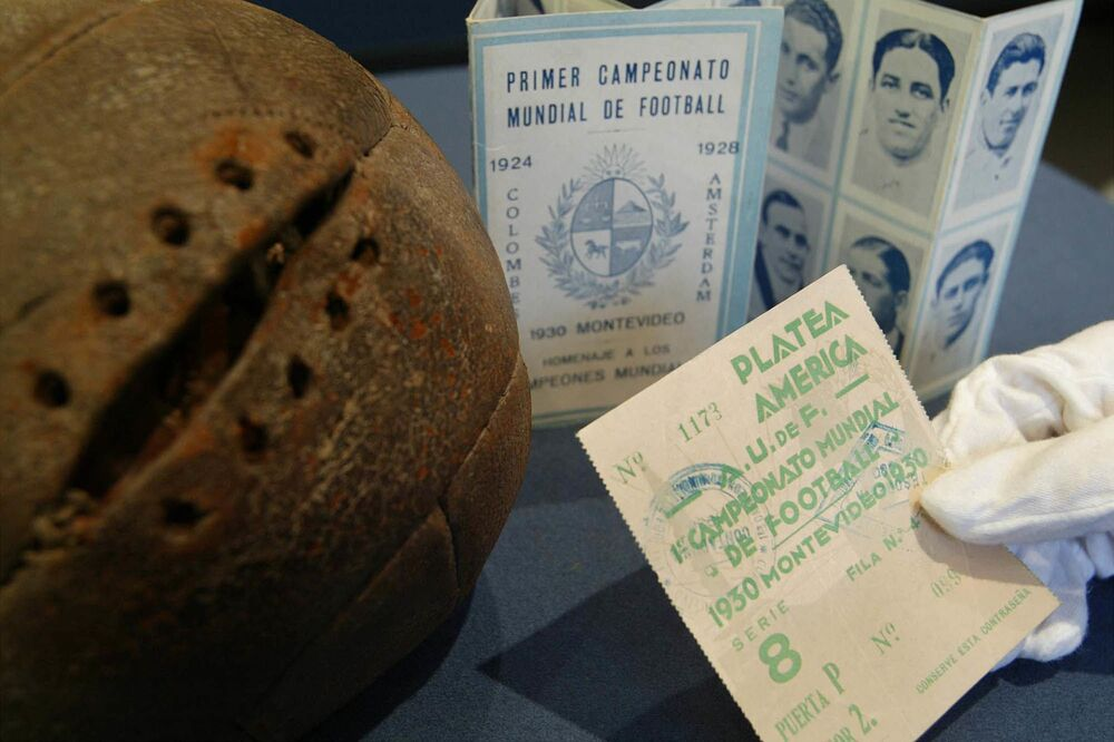 The opening leather football from the World Cup Final (left) with a ticket to the final game (front) and a programme showing photos (back) of both teams at the Bonhams Auction House, 26 March 2003. (AP Photo)