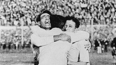 Uruguayans Pedro Cea, Hector Scarone and Hector Castro (from L) celebrate after Uruguay beat Argentina 4-2 in the first-ever World Cup soccer final in Montevideo 30 July 1930
