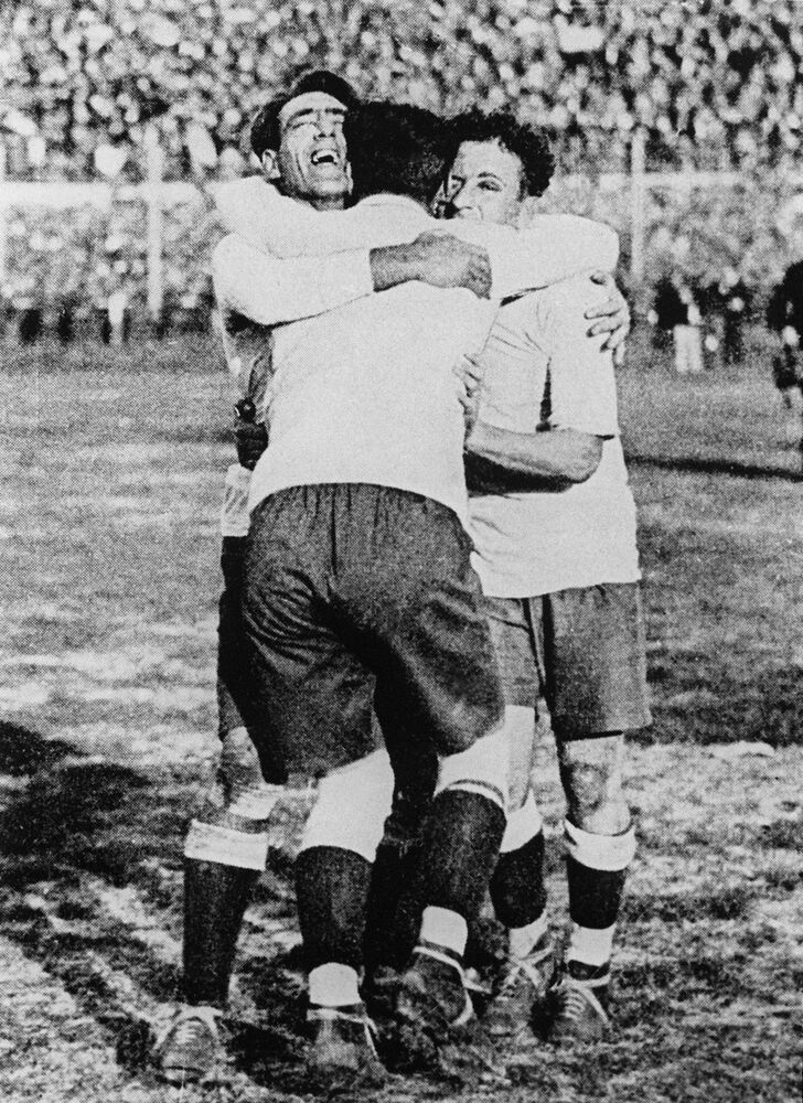 Uruguay's Pedro Cea, Héctor Scarone and Héctor Castro (left to rgiht) celebrate after Uruguay beat Argentina 4-2 in the first World Cup Final in Montevideo on 30 July 1930. (STF/AFP)