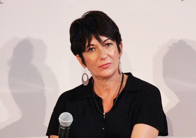 In this file photo taken on September 20, 2013, Ghislaine Maxwell attends day 1 of the 4th Annual WIE Symposium at Center 548  in New York City