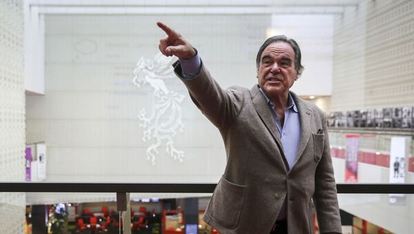 In this photo provided by Tasnim News Agency, American movie director Oliver Stone points in a photo opportunity while attending the Fajr International Film Festival, in Tehran, Iran, Monday, April 23, 2018 - Sputnik International