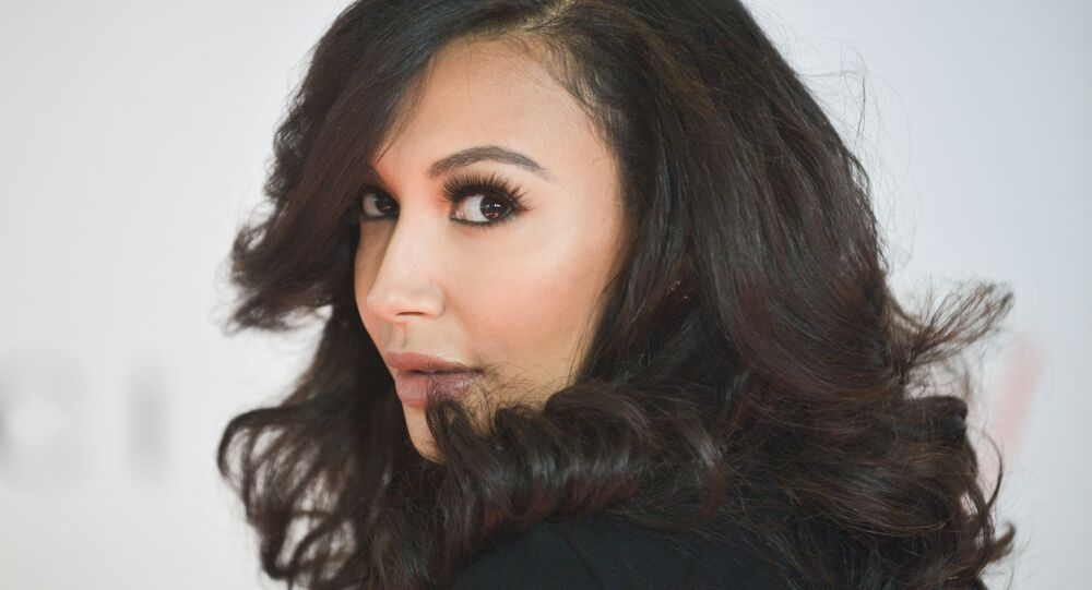 Naya Rivera arrives at the 22nd Annual Women in Entertainment Breakfast at the Beverly Hills Hotel on Wednesday, Dec. 11, 2013 in Beverly Hills, Calif
