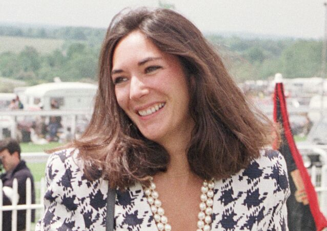 In this June 5, 1991 file photo, British socialite Ghislaine Maxwell arrives at Epsom Racecourse. The FBI said Thursday July 2, 2020, Ghislaine Maxwell, who was accused by many women of helping procure underage sex partners for Jeffrey Epstein, has been arrested in New Hampshire.
