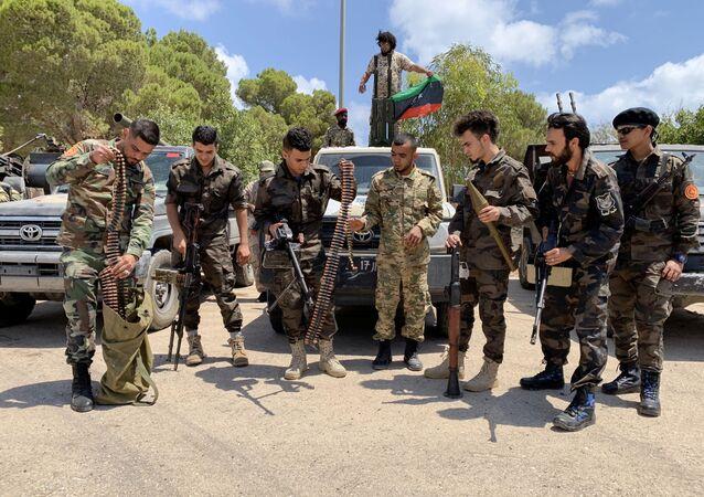 Troops loyal to Libya's internationally recognized government prepare before heading to Sirte, in Tripoli, Libya, Libya July 6, 2020.