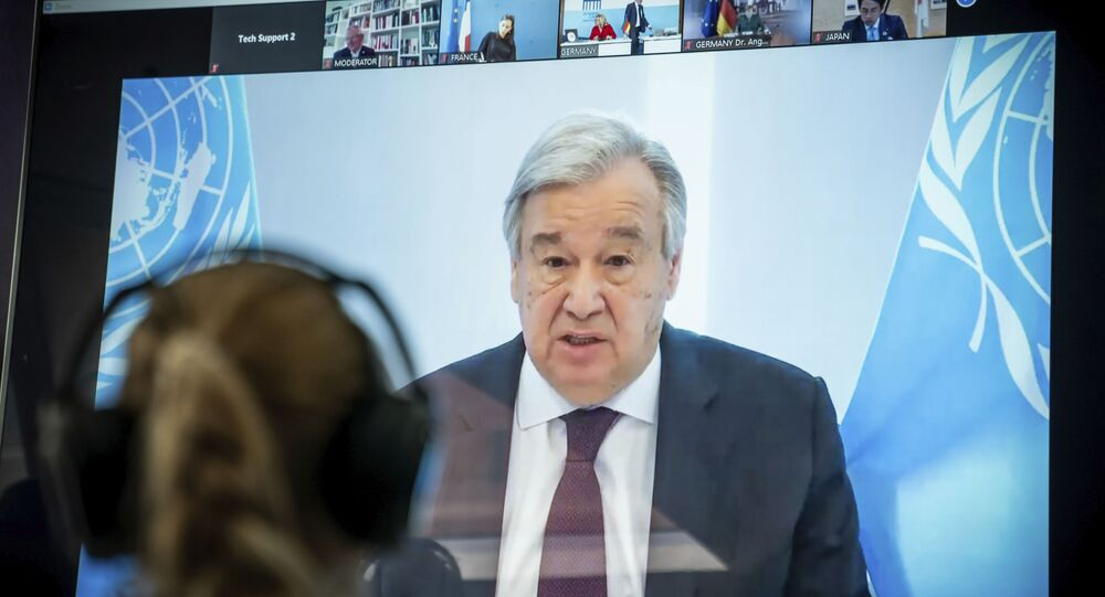 Antonio Guterres, UN Secretary-General displayed on a screen at the  Environment Ministry as he delivers his speech at the Petersberg Climate Dialogue, in Berlin, Germany, Tuesday, April 28, 2020.