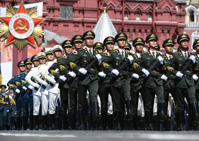 Soldiers of China's People's Liberation Army march during the Victory Day Parade in Red Square in Moscow, Russia, June 24, 2020. The military parade, marking the 75th anniversary of the victory over Nazi Germany in World War Two, was scheduled for May 9 but postponed due to the outbreak of the coronavirus disease (COVID-19).