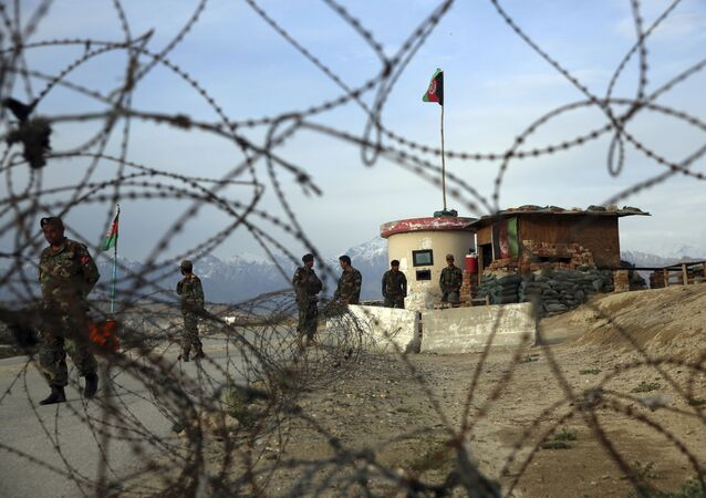 Afghan National Army soldiers stand guard at a checkpoint near the Bagram base in northern Kabul, Afghanistan, Wednesday, 8 April 2020