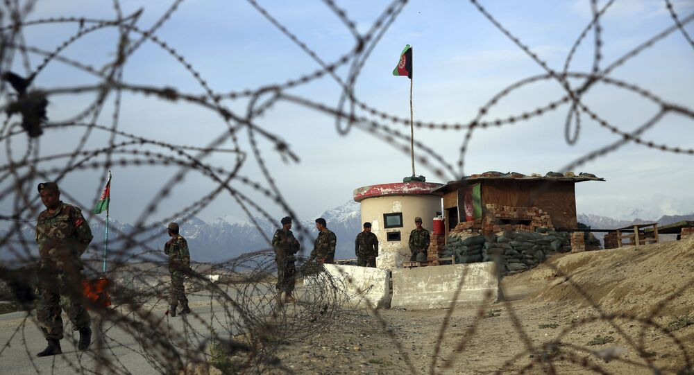 Afghan National Army soldiers stand guard at a checkpoint near the Bagram base in northern Kabul, Afghanistan, Wednesday, April 8, 2020