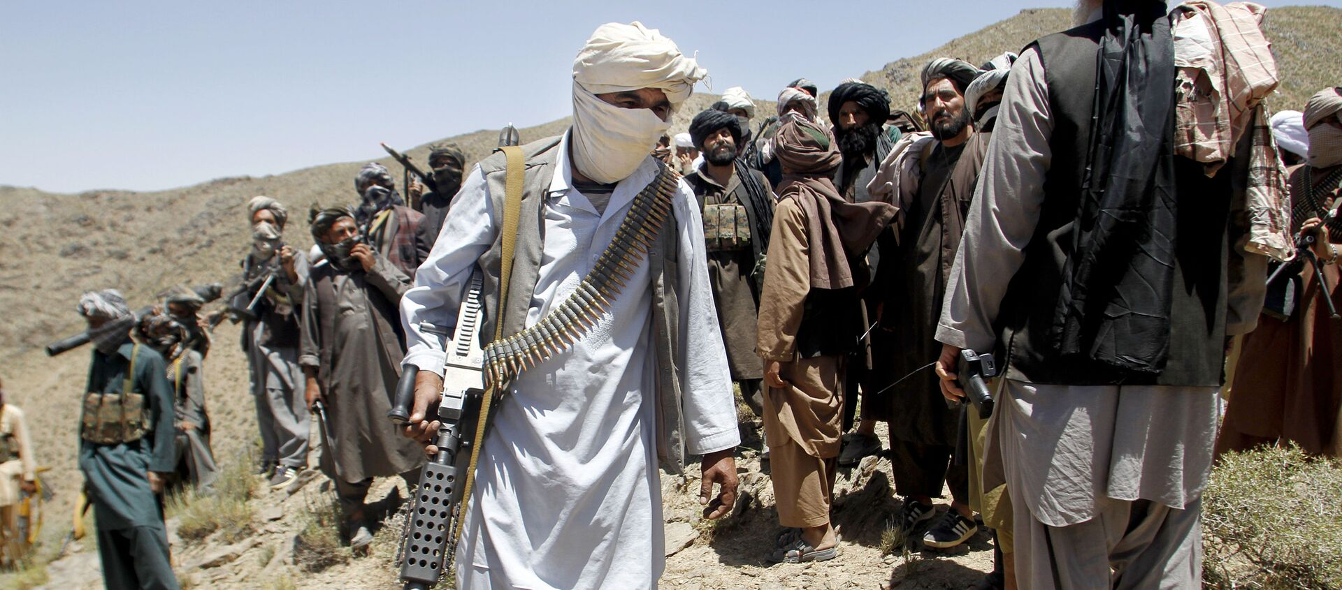 In this Friday, May 27, 2016 photo, members of a breakaway faction of the Taliban fighters walks during a gathering, in Shindand district of Herat province, Afghanistan - Sputnik International, 1920, 20.04.2021