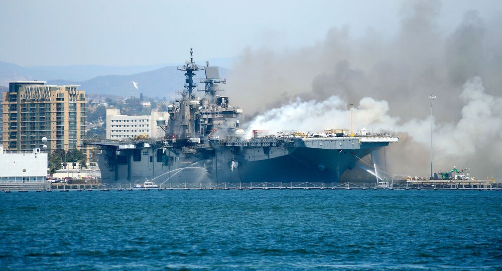 Port of San Diego Harbor Police Department boats combat a fire on board the U.S. Navy amphibious assault ship USS Bonhomme Richard at Naval Base San Diego, California, U.S. July 12, 2020