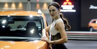 A model wearing a face shield poses with a Mitsubishi vehicle during the media day of the 41st Bangkok International Motor Show after the Thai government eased measures to prevent the spread of the coronavirus disease (COVID-19) in Bangkok, Thailand July 14, 2020.