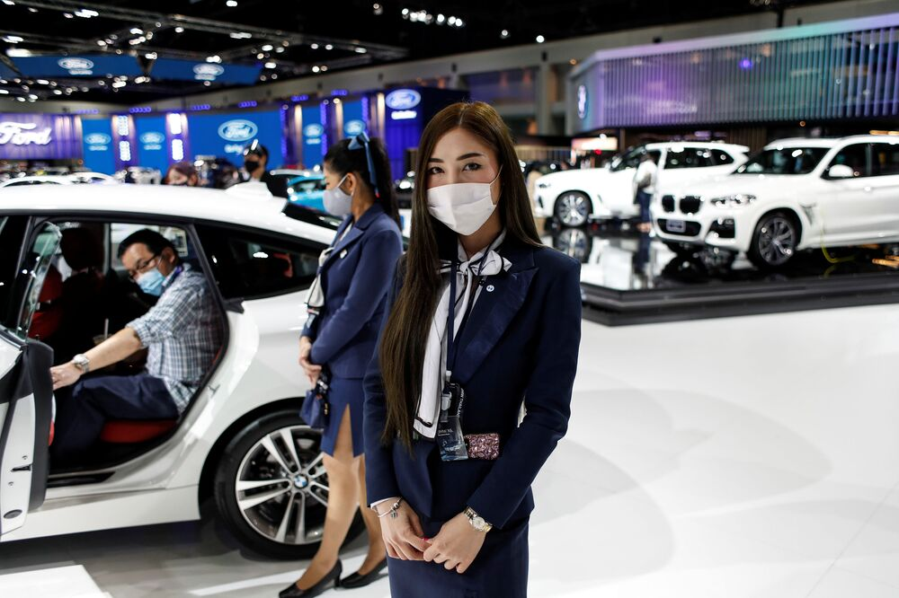 A representative of a BMW dealership wears a face mask during the media day of the 41st Bangkok International Motor Show after the Thai government eased measures to prevent the spread of the coronavirus disease (COVID-19) in Bangkok, Thailand July 14, 2020.
