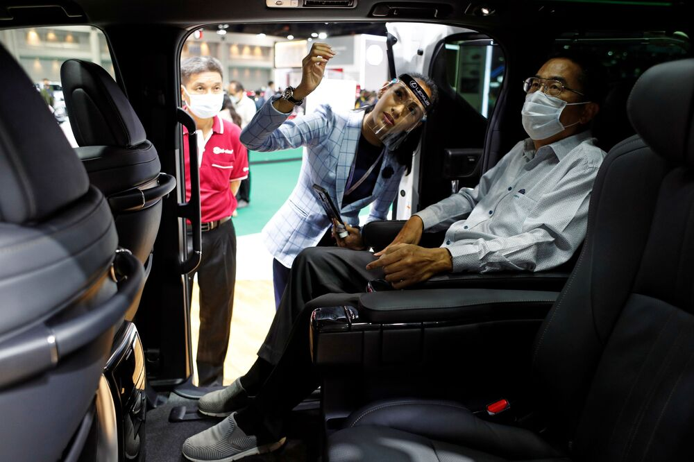 A customer sits inside a Lexus LM 300h during the media day of the 41st Bangkok International Motor Show after the Thai government eased measures to prevent the spread of the coronavirus disease (COVID-19) in Bangkok, Thailand July 14, 2020.