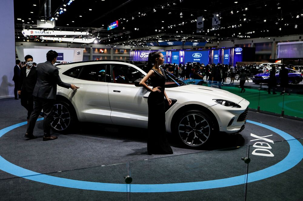 A model wearing a face shield poses with an Aston Martin DBX during the media day of the 41st Bangkok International Motor Show after the Thai government eased measures to prevent the spread of the coronavirus disease (COVID-19) in Bangkok, Thailand July 14, 2020.