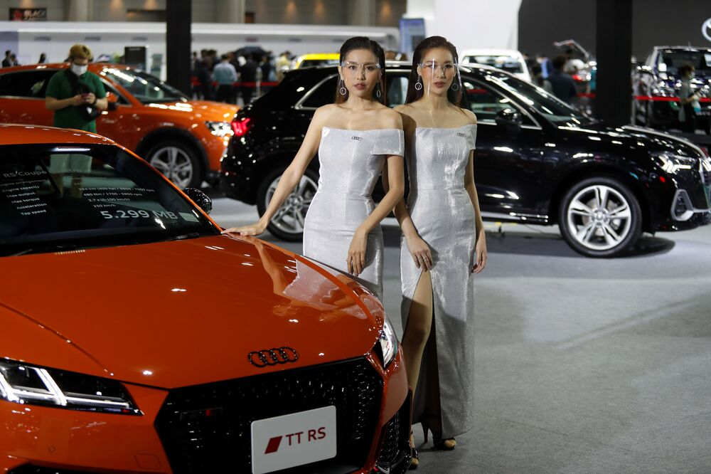 Models wearing face shields pose with an Audi TT RS Coupe during the media day of the 41st Bangkok International Motor Show after the Thai government eased measures to prevent the spread of the coronavirus disease (COVID-19) in Bangkok, Thailand July 14, 2020.