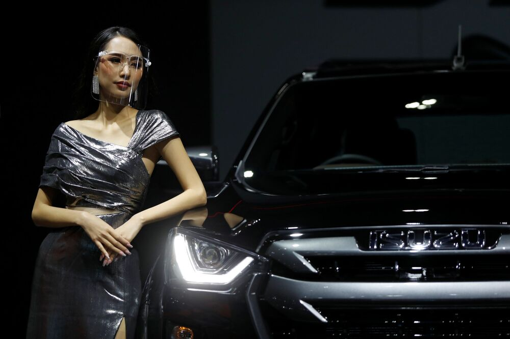 A model leans against an Isuzu vehicle during the media day of the 41st Bangkok International Motor Show after the Thai government eased measures to prevent the spread of the coronavirus disease (COVID-19) in Bangkok, Thailand July 14, 2020.