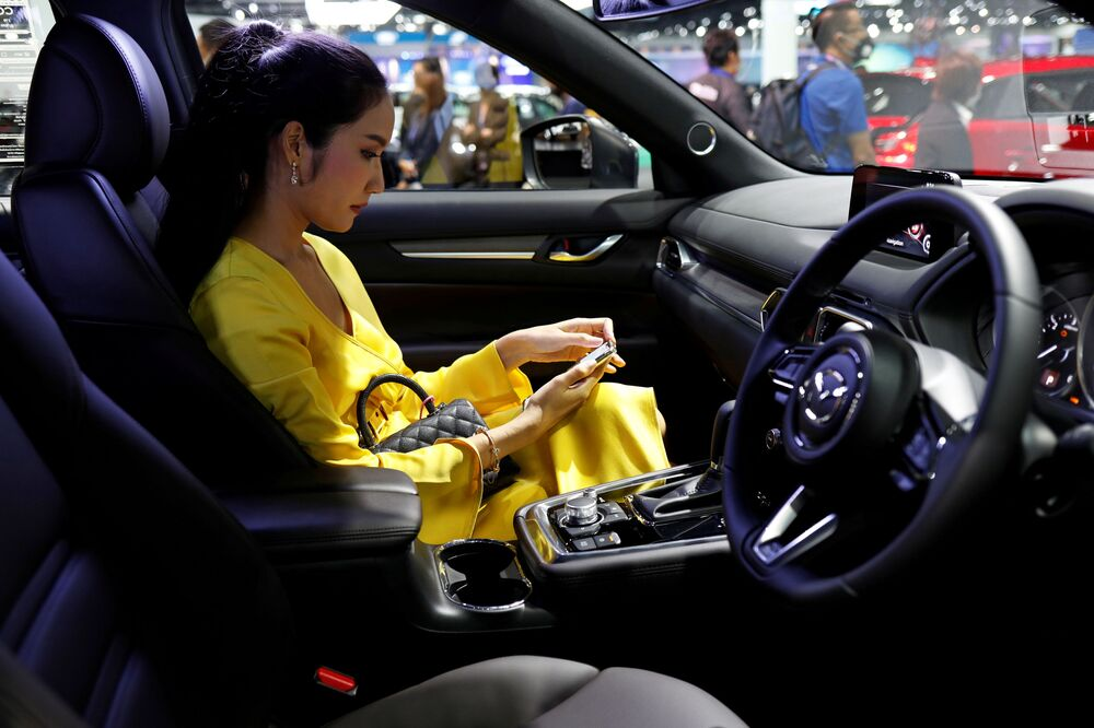 A customer sits in a Mazda CX-8 during the media day of the 41st Bangkok International Motor Show after the Thai government eased measures to prevent the spread of the coronavirus disease (COVID-19) in Bangkok, Thailand July 14, 2020.