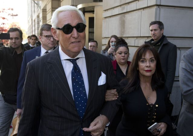 In this 15 November 2019 file photo, Roger Stone, left, with his wife Nydia Stone, leaves federal court in Washington
