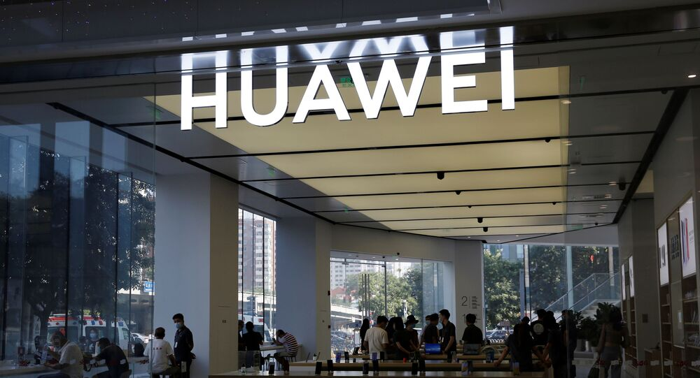 People are seen inside a Huawei store at a shopping mall in Beijing, China, 14 July 2020
