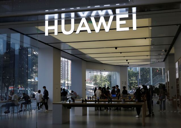 People are seen inside a Huawei store at a shopping mall in Beijing, China July 14, 2020