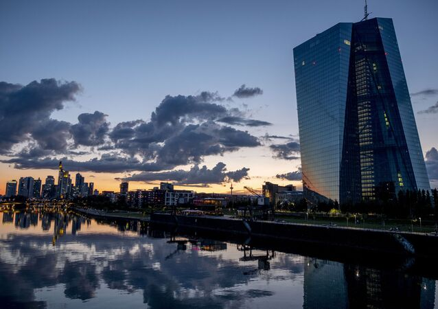 Clouds are seen over the buildings of the banking district and the European Central Bank, right, after sunset in Frankfurt, Germany, Thursday, June 18, 2020