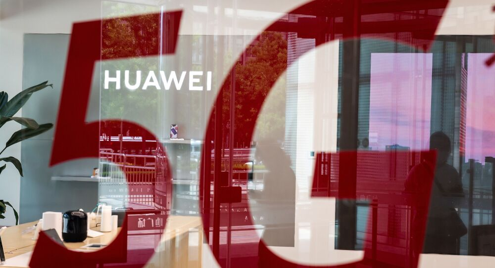 (FILES) This file photo taken on May 25, 2020, shop for Chinese telecom giant Huawei features a red sticker reading 5G in Beijing on May 25, 2020