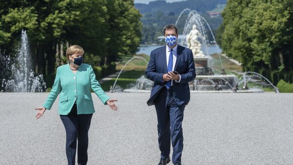 German Chancellor Angela, left, and Markus Soeder, right, Governour of the German state of Bavaria, arrive at the Herrechiemsee island, Germany, Tuesday, July 14, 2020 - Sputnik International