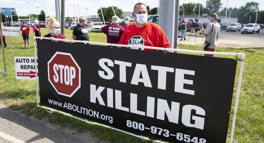 Protesters against the death penalty gather in Terre Haute, Ind., Monday, July 13, 2020