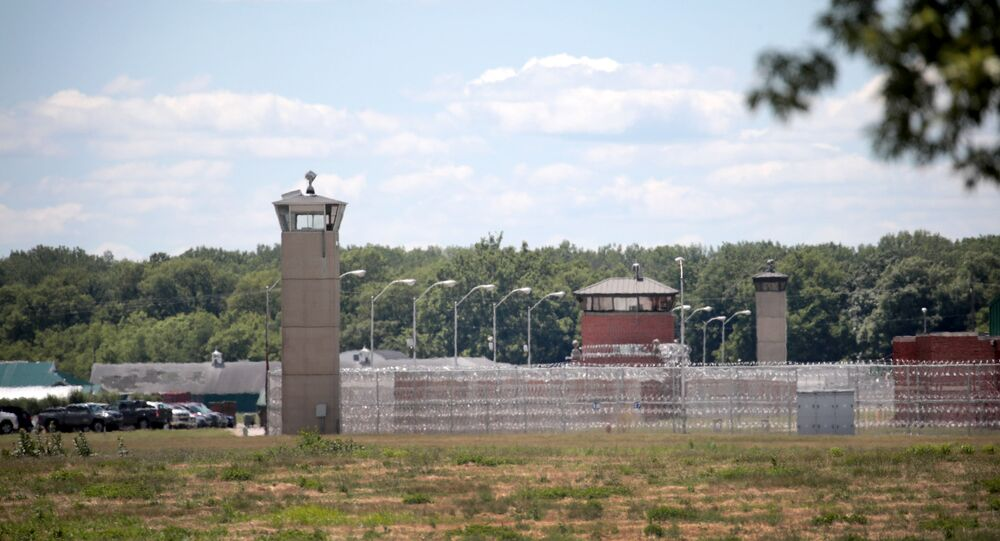 A guard tower sits along a security fence at the Federal Correctional Complex where Daniel Lewis Lee was executed on July 14, 2020 in Terre Haute, Indiana.