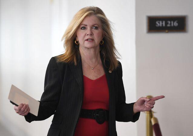 Sen. Marsha Blackburn, R-Tenn., heads into a Republican policy lunch on Capitol Hill in Washington, Thursday, March 19, 2020.