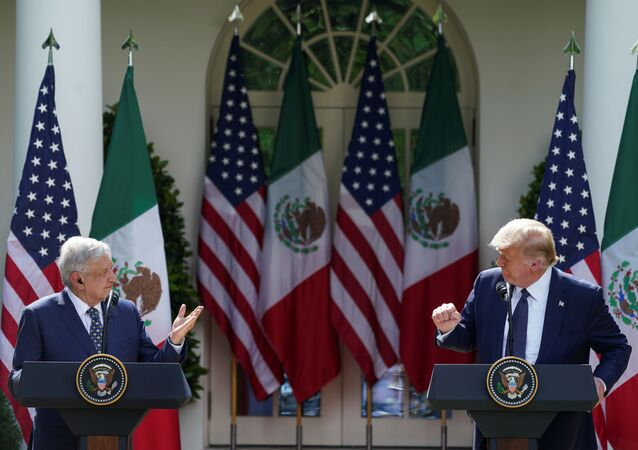 U.S. President Donald Trump listens to Mexico's President Andres Manuel Lopez Obrado as the leaders deliver individual statements prior to signing a joint declaration in the Rose Garden at the White House in Washington, U.S., July 8, 2020