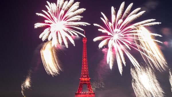 Fireworks illuminate the Eiffel Tower in Paris during Bastille Day celebrations late Sunday, July 14, 2019. Bastille Day marks the July 14, 1789, storming of the Bastille prison by angry Paris crowds that helped spark the French Revolution. - Sputnik International