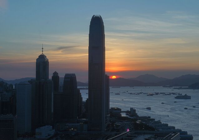 The skyline of the business district is silhouetted at sunset in Hong Kong Monday, 13 July 2020.