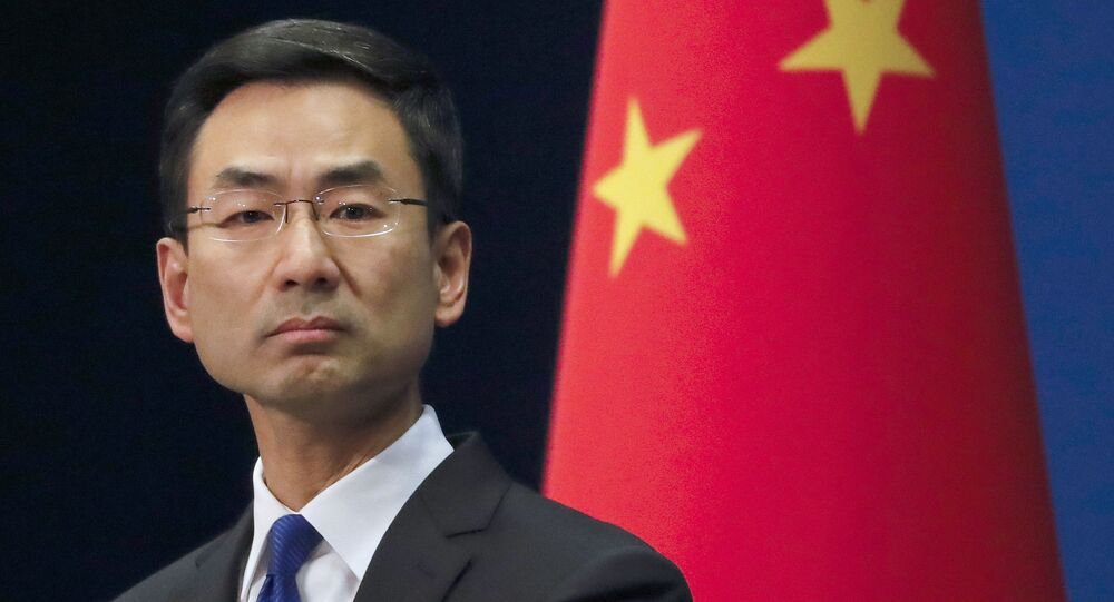 In this March 18, 2020, file photo, Chinese Foreign Ministry spokesman Geng Shuang listens to a question during a daily briefing at the Ministry of Foreign Affairs office in Beijing. Lawsuits are starting to pile up around the U.S. seeking to hold China accountable for the coronavirus pandemic