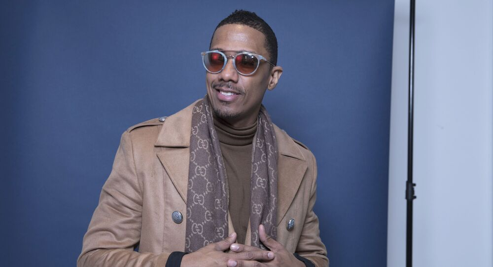 In this Dec. 10, 2018 photo, Nick Cannon poses for a portrait in New York to promote promoting his new show, The Masked Singer