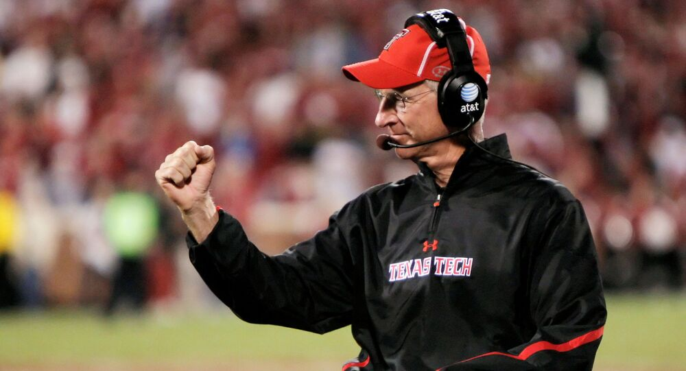Texas Tech head coach Tommy Tuberville celebrates a touchdown in the second half of the NCAA Big 12 Conference football game against the University of Oklahoma in Norman, Oklahoma, 22 October 2011.