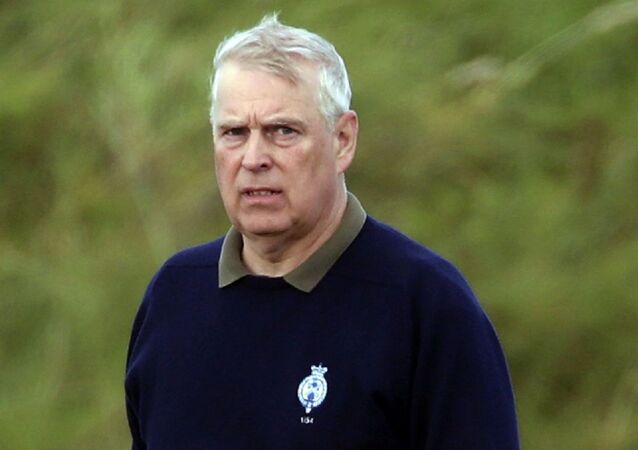Britain's Prince Andrew, center, attends the Duke of York Young Champions Trophy at the Royal Portrush Golf Club in County Antrim, Northern Ireland, Monday, Sept. 9, 2019