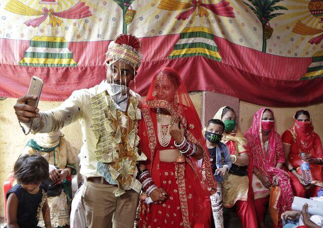 Couple Sachin Chandaliya and SonIya Bohat take a selfie after getting married at a marriage bureau at Bandra in Mumbai, India, Monday, June 15, 2020