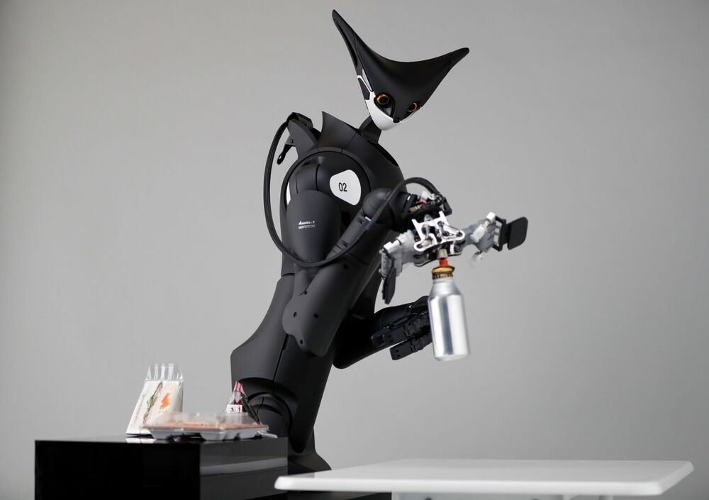 Telexistence's shelf-stacking avatar robot, designed to resemble a kangaroo and developed to work in a convenience store, is demonstrated during a photo opportunity ahead of its unveiling in Tokyo, Japan July 3, 2020.